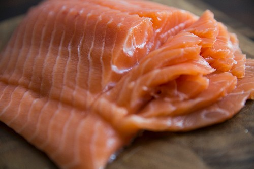 A side of salmon with slices cut into it