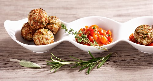Rice and meatballs with a tomato and pepper sauce