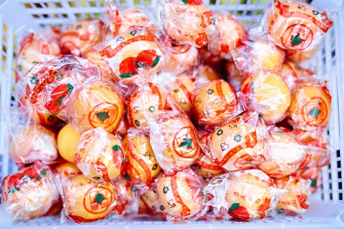 Oranges in cellophane in a crate (Bali)