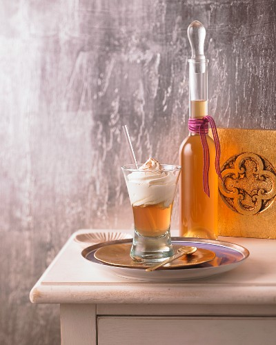 Baked apple liqueur in a glass and a bottle