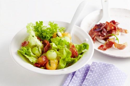 Mixed leaf salad with melon and crispy Serrano ham