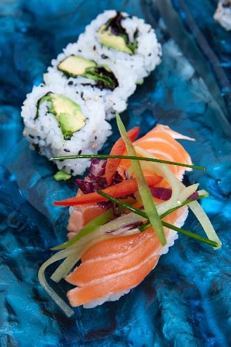 Nigiri sushi with salmon and maki with avocado