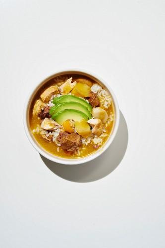 Sancocho soup with chicken, corn, plantains, chicken stock, yucca, coriander and avacado (Puerto Rico)