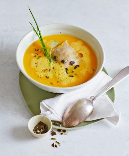 Foamy Muscade de Provence pumpkin soup with goat's cheese ravioli