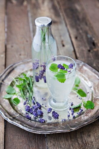 A gin and tonic with lavender flowers
