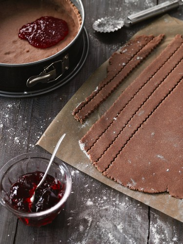Strips of pastry being cut for a Linz tart