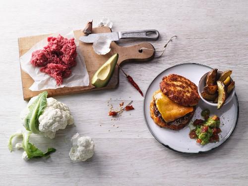 Gluten-free burger with garlic wedges and avocado salsa