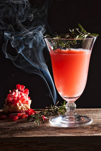 A pomegranate cocktail with rosemary