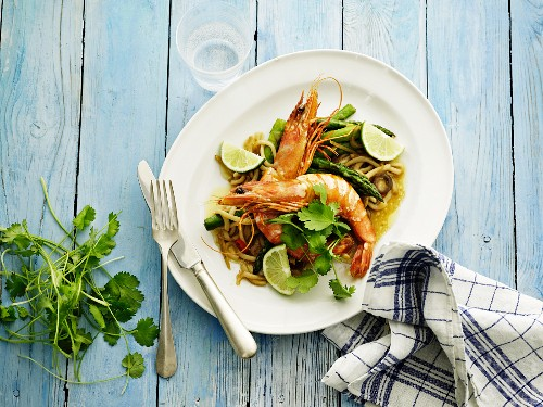 King prawns with coriander and lime on a bed of udon noodles