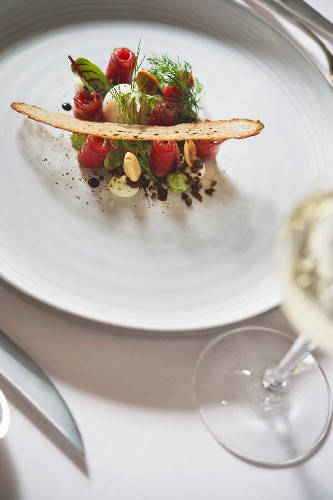 A dish by TV chef Frank Buchholz: marinated beef with a poached quail's egg