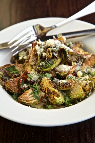 Grilled Brussels sprouts with a Caesar salad dressing