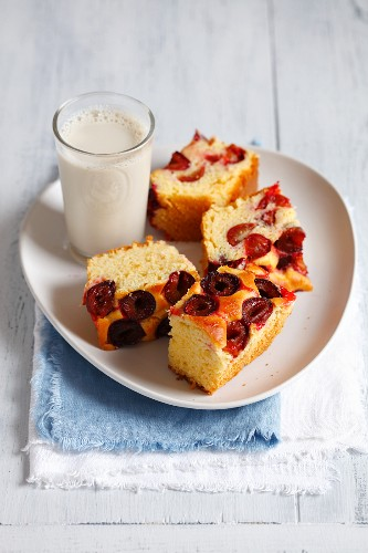 Yeast cake with plums served with a glass of soya milk