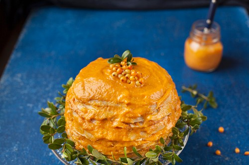 A pancakes cake with pumpkin and sea buckthorn