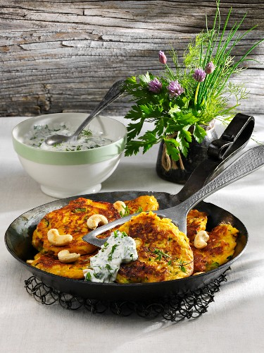 Pumpkin and courgette cakes with herb yogurt