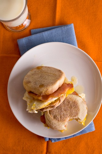 English muffins with egg, Canadian Cheddar and bacon for breakfast