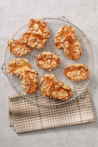 Almond biscuits on a wire rack (seen from above)