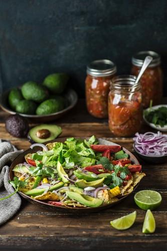 Nachos salad with avocado, tomatoes, sweetcorn and onions (Mexico)