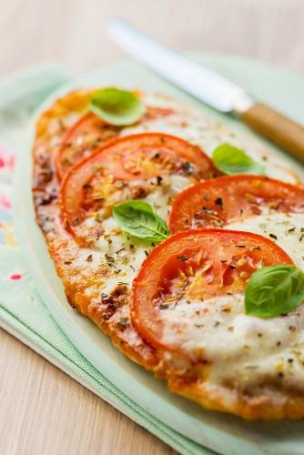 Pita bread pizza with tomatoes, mozzarella and basil