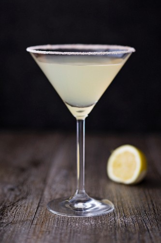 A Margarita in a stemmed glass with a salted rim