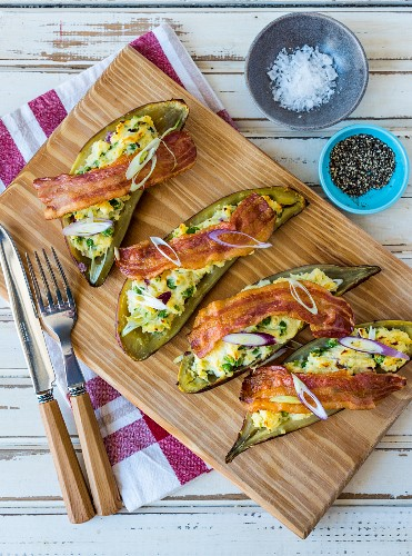 Stuffed sweet potatoes with bacon and onions