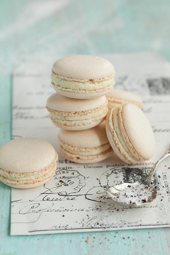 Vanilla macaroons on an old piece of writing