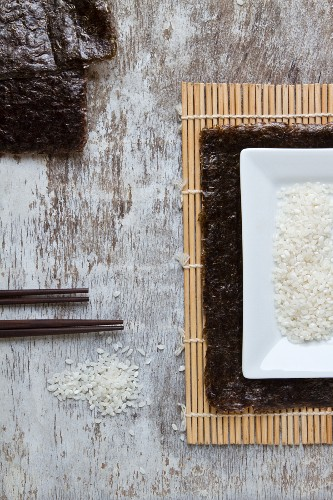 Ingredients for sushi on a bamboo mat