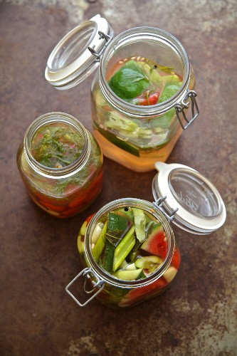 Pickled vegetables from Russia (watermelon, cucumber, celery, tomatoes, garlic, dill) in jars