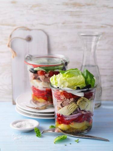 Layered salad Niçoise with tuna fish in jars