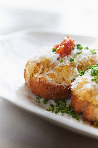 Bruschetta topped with cheese and chives