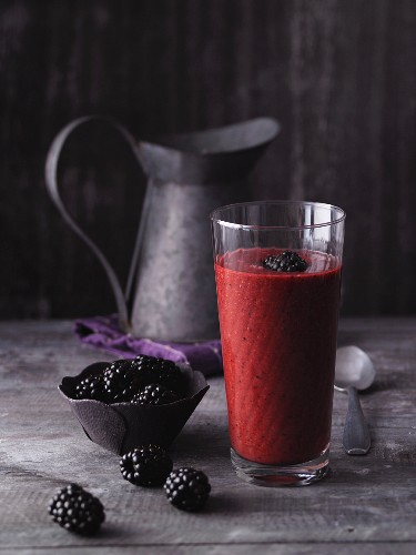 A plum and blackberry smoothies with an almond drink and acai powder