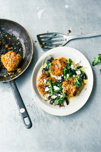 Sweet potato fritters with goat's cheese, black olives and rocket butter