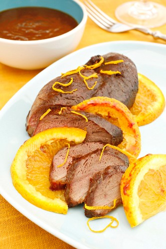Fried duck breast with orange sauce