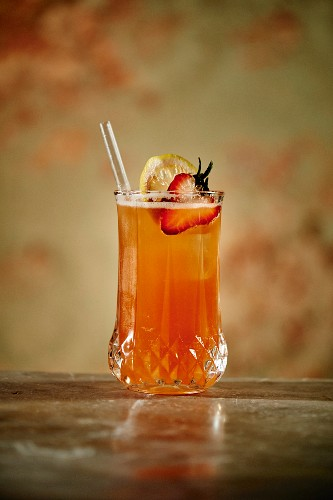 Kentucky Buck Cocktail made with strawberries, bourbon, lemon juice, bitters, ginger beer, a lemon slice and syrup