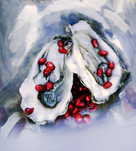 Oysters with pomegranate seeds (seen from above)