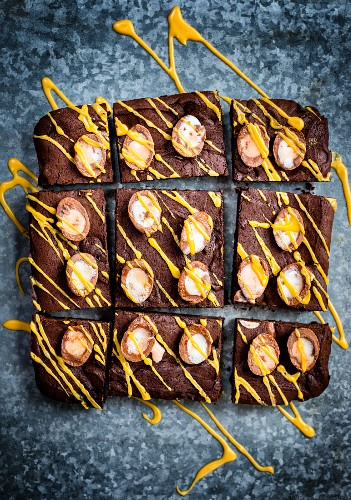 Chocolate brownies with mini Easter eggs and yellow icing