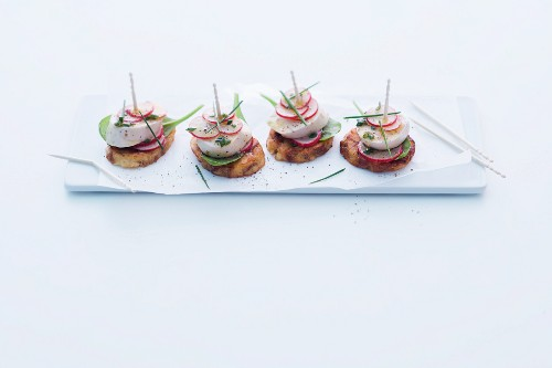 Pretzel dumpling crostini with white sausages and radishes