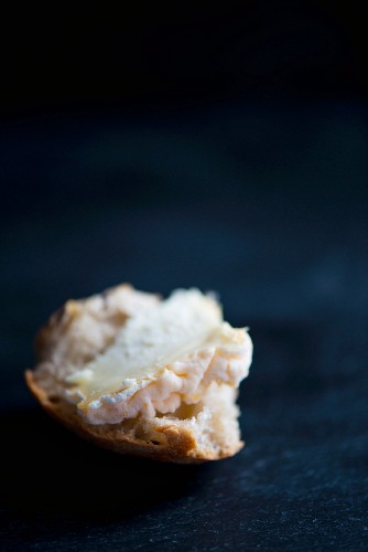 Langres cheese from the Region Champagne-Ardenne rregion in France on a slice of baguette