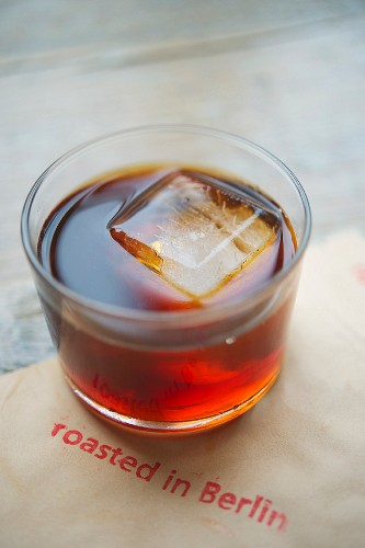 Cold coffee with an ice cube in a glass, roasting house and cafe 'The Barn', Berlin