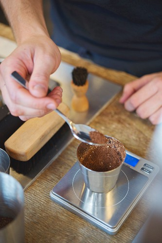 Ground coffee being weighed at the roasting house and cafe 'The Barn' in Berlin