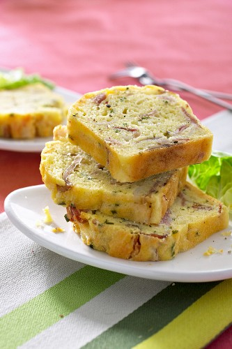 Savoury cake with ham, basil and olive oil