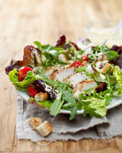 Caesar salad with turkey breast