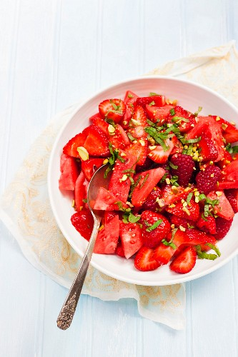 Red berry and watermelon salad with pistachio nuts and mint