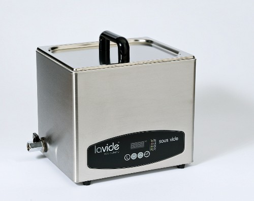 A sous vide machine on a white surface