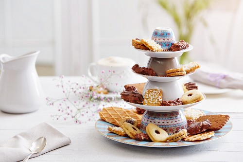 Various biscuits on a cake stand made of overturned cups and plates