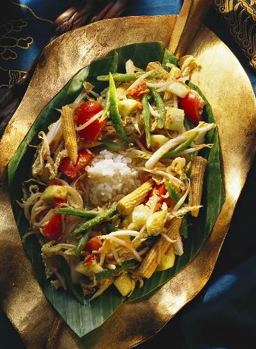 Indonesian vegetable salad with coconut sauce on rice (Urab)