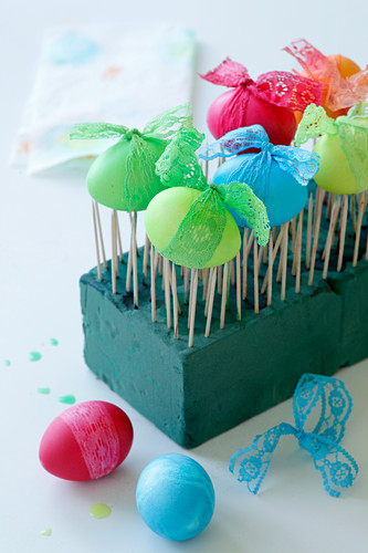 Easter eggs drying on toothpicks
