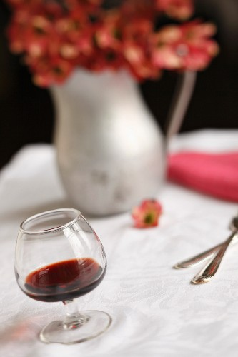 Glass of Cassis with a Pitcher of Dogwood Blossoms