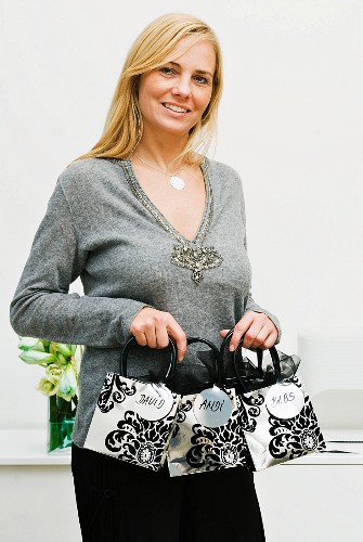 A woman holding Christmas gift bags