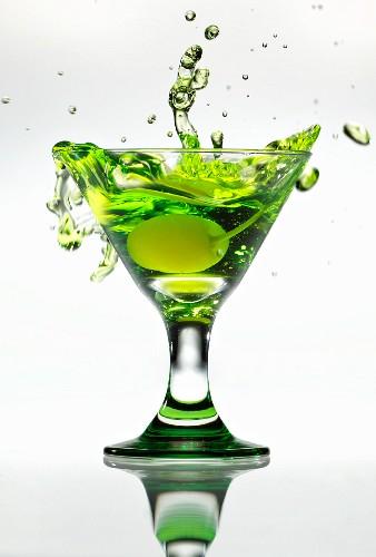 Yellow Cherry Splashing into a Green Apple Martini