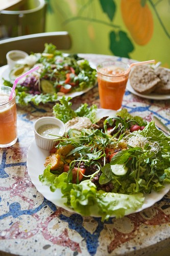 Large plates of salad with dressing